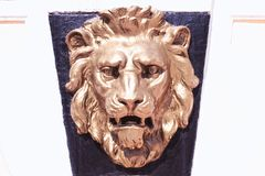 Bronze lion's head on the wall Royalty Free Stock Image