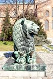 A Bronze lion sculpture in front of the Byzantine Church St Sophia Royalty Free Stock Photography