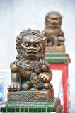 Bronze Lion Statue. S   At A Chinese Temple. The Lions Are Always In Pair Royalty Free Stock Photo
