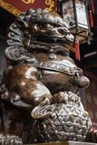 Bronze lion statue in China. Bronze lion statue in a buddhist temple, Chengdu, China royalty free stock photography