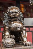 Bronze lion statue in China. Bronze lion statue in a buddhist temple, Chengdu, China royalty free stock photo