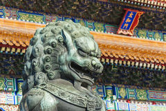 The bronze lion statue in Forbidden City Stock Photo