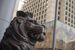 The bronze lion statue in front of the HSBC building stock photo