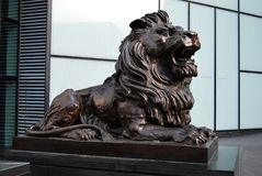 Bronze Lion Statue or Sculpture. Outside the worldwide headquarters of HSBC, The North Colonnade, London Docklands stock image