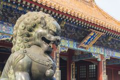 Bronze Lion Statue in Summer Palace, Beijing. Beijing, China - Mar 19, 2018: Bronze Lion Statue in Summer Palace, Beijing. It is an imperial garden in Qing Stock Photos