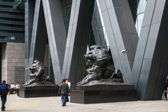 He bronze lion statues at the entrance of the Shenzhen Stock Exchange Operation Center. Shenzhen, China - November 11, 2015: The bronze lion statues at the stock photos