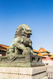 Bronze lions in the imperial palace Stock Photos