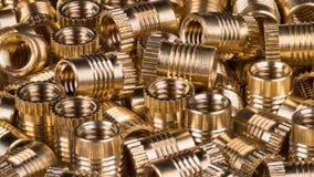 Bronze lustroso buchas rosqueadas como o fundo foto de stock