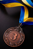 Bronze medal on a dark background Royalty Free Stock Photography