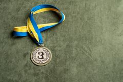 The bronze medal for third place with yellow-blue ribbon, copy-space stock photo