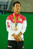 Bronze medalist Kei Nishikori of Japan during tennis men`s singles medal ceremony of the Rio 2016 Olympic Games Royalty Free Stock Images