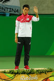Bronze medalist Kei Nishikori of Japan during tennis men`s singles medal ceremony of the Rio 2016 Olympic Games Royalty Free Stock Photo