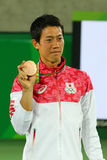 Bronze medalist Kei Nishikori of Japan during tennis men`s singles medal ceremony of the Rio 2016 Olympic Games Royalty Free Stock Photography