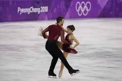 Bronze medalists  Meagan Duhamel and Eric Radford of Canada perform in the Pair Skating Free Skating at the 2018 Winter Olympics Stock Photos