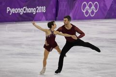 Bronze medalists  Meagan Duhamel and Eric Radford of Canada perform in the Pair Skating Free Skating at the 2018 Winter Olympics. GANGNEUNG, SOUTH KOREA Royalty Free Stock Photos