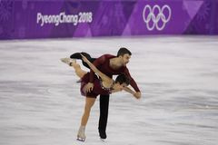 Bronze medalists  Meagan Duhamel and Eric Radford of Canada perform in the Pair Skating Free Skating at the 2018 Winter Olympics. GANGNEUNG, SOUTH KOREA Royalty Free Stock Image