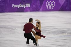 Bronze medalists  Meagan Duhamel and Eric Radford of Canada perform in the Pair Skating Free Skating at the 2018 Winter Olympics Royalty Free Stock Photo