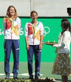 Bronze medalists team Czech Lucie Safarova (L) and Barbora Strycova during medal ceremony after tennis doubles final Royalty Free Stock Photography