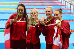 Bronze medalists Team Denmark Women`s 4  100m medley relay at the Rio 2016 Olympics Stock Image