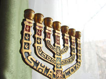 Bronze menorah at window Royalty Free Stock Photo