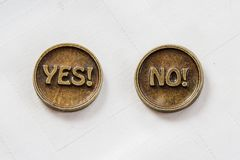 Bronze metal coins Yes or No. Coin for make choice. On white background. Decision making.  royalty free stock photography