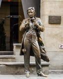Bronze monument Leopold Ritter von Sacher-Masoch on the streets of Lviv, Ukraine. Bronze monument Leopold Ritter von Sacher-Masoch on the streets Royalty Free Stock Images