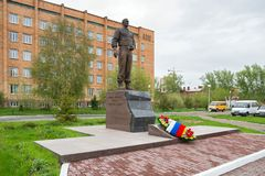 Bronze monument to General Lebed against the background of the building and parking. KRASNOYARSK, RF - May 14, 2017: General Alexander Lebed was governor of the royalty free stock photos