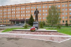 A bronze monument to General Lebed against the background of the Cadet School. KRASNOYARSK, RF - May 14, 2017: General Alexander Lebed was governor of the royalty free stock photography