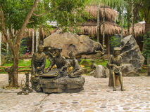 Bronze monument of traditional life style of Li tribe in China stock photos