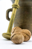 Bronze mortar with walnuts. On isolated white background Stock Photography