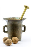 Bronze mortar with walnuts. On isolated white background Royalty Free Stock Photography