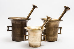 Bronze mortars. Three vintage mortars on a white background royalty free stock photography