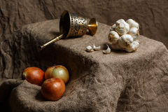 Bronze morter and group of garlics and onions Stock Photography