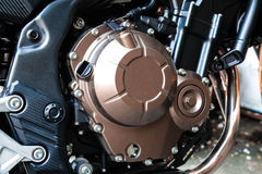A bronze motorcycle engine Royalty Free Stock Image