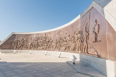 Bronze mural at Heroes Acre in Windhoek. WINDHOEK, NAMIBIA - JUNE 16, 2017: A bronze mural at Heroes Acre, depicting the struggle of indigenous Namibians, at Stock Image
