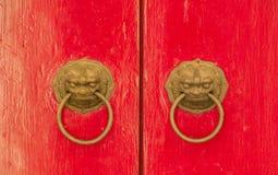 Bronze nandle on red door Stock Image