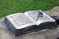 Bronze open book with pen and ink as a monument Royalty Free Stock Photo