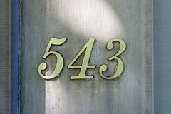 House number five hundred and forty three 543. Bronze ouse number five hundred and forty three 543 Stock Images