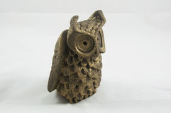 A bronze owl paperweight. A bronze owl decorative paperweight Stock Photo