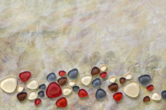 Bronze paint with glass pebbles - mosaics Stock Images