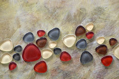 Bronze paint with glass pebbles - mosaics Stock Image