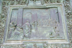 Bronze panel detail of the entrance door of Pisa Cathedral Stock Photo