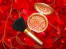 Bronze pearls. In rose petals background stock image