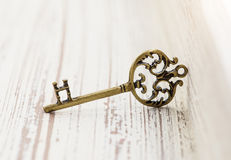 Bronze pendant in form of a key. Stock Photography
