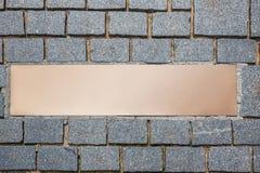 A bronze plaque on the cobblestones Stock Image