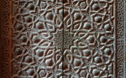 Bronze-plate door ornaments at mosque of Sultan Hassan decorated with floral and geometric patterns, Cairo, Egypt royalty free stock image