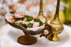 Potpourri bronze plate and fragrance pots Royalty Free Stock Photos