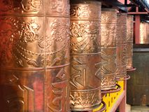 Bronze prayer wheels, spinning Buddhist prayer drums at The Putuo Zongcheng Buddhist Temple stock photos