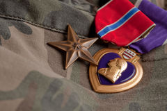 Bronze and Purple Heart Medals on Camouflage Mater Stock Photos