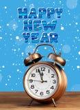 Bronze retro alarm clock at twelve o`clock amid flying snow. Stock Photography